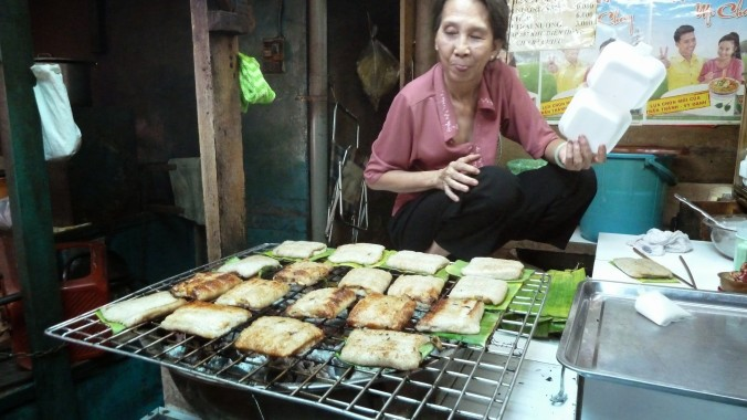 Sticky rice with a gooey coconut center, wrapped in banana leaves and BBQd