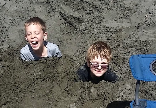 Burying George and Ethan in the sand