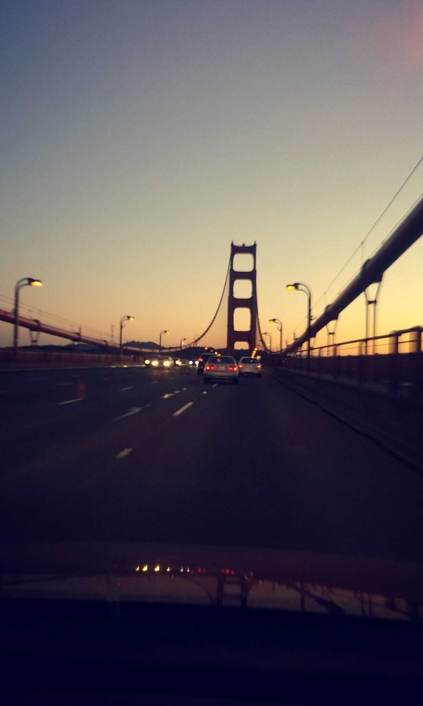 Driving across the Golden Gate Bridge at sunset