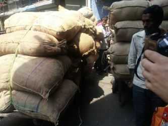 Cramped, hot and dusty in the spice market, Old Delhi.