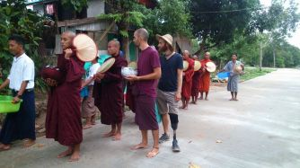Morning alms rounds with the monks