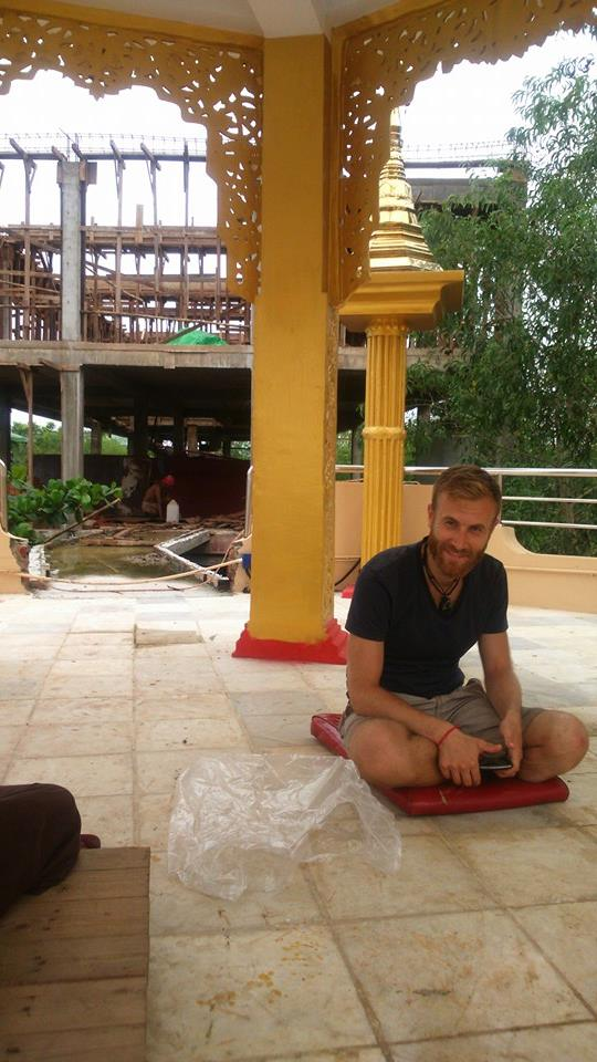 Meditation session on a pagoda rooftop.